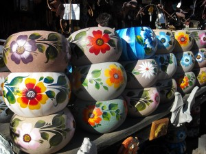 Rolls of pots catching the sunlight. Capturing someone's eyes and brightening the day.