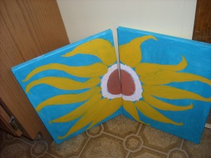 A painting in progress of a sunflower. Notice the bright blues and yellows. They help to pick up your mood.