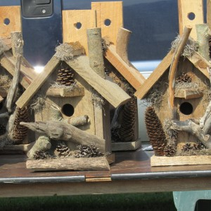 Wooden bird houses; roll after roll, all looking the same