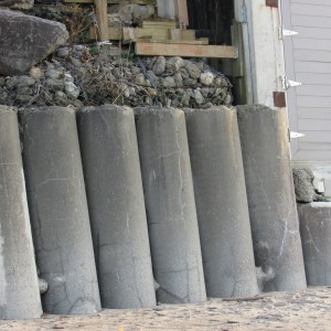 Rolls of cement; circling and protecting from the rough waters of winter